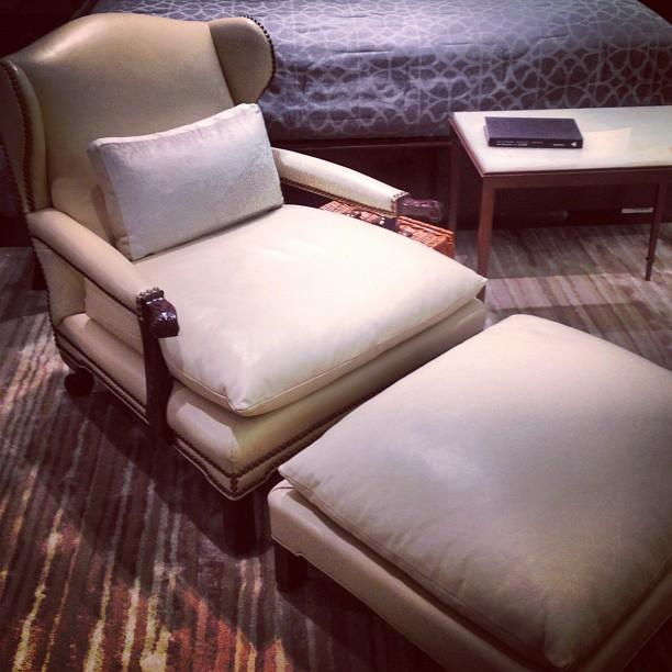 Chanintr leather chair with stool.